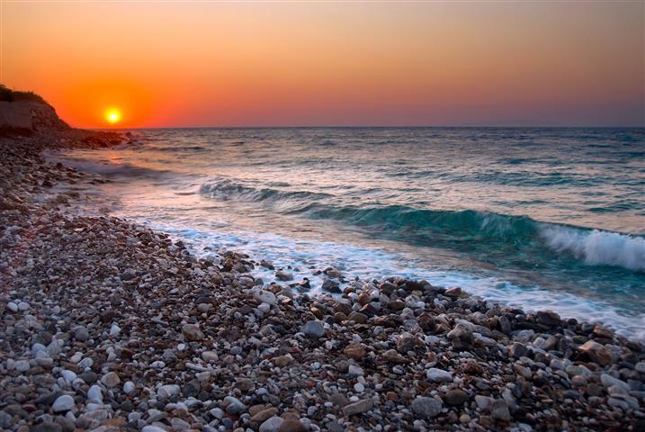 Фотошпалери океан камені захід сонця пляж